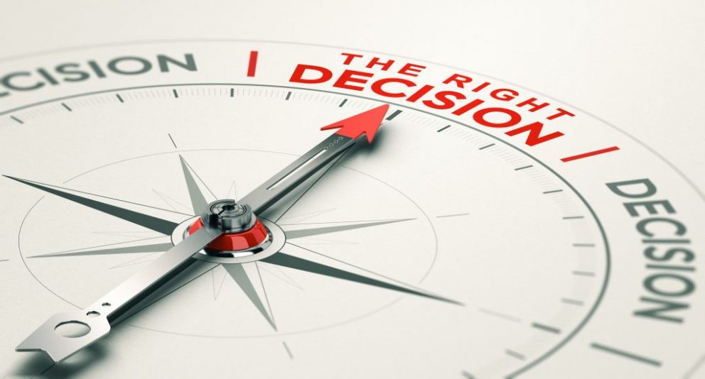 Compass pointing toward the right decision