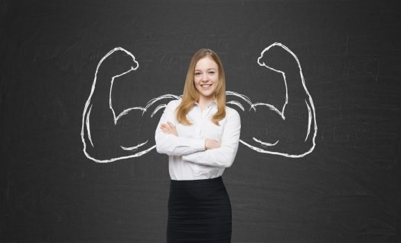 Woman with drawn muscular arms behind her
