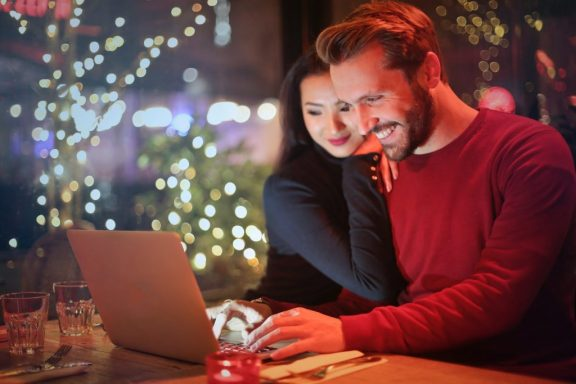 Couple looking at laptop during Christmas